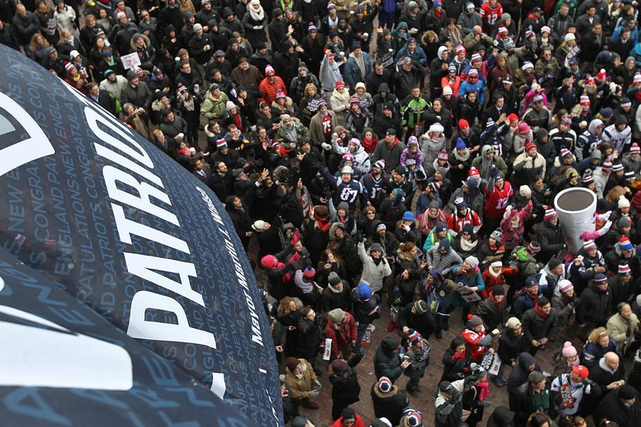 A banner was unfurled from City Hall to salute the Patriots.